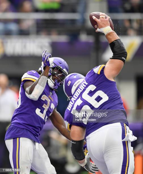 Dalvin Cook of the Minnesota Vikings looks on as Garrett Bradbury spikes the ball after a touchdown against the Atlanta Falcons by Cook during the...