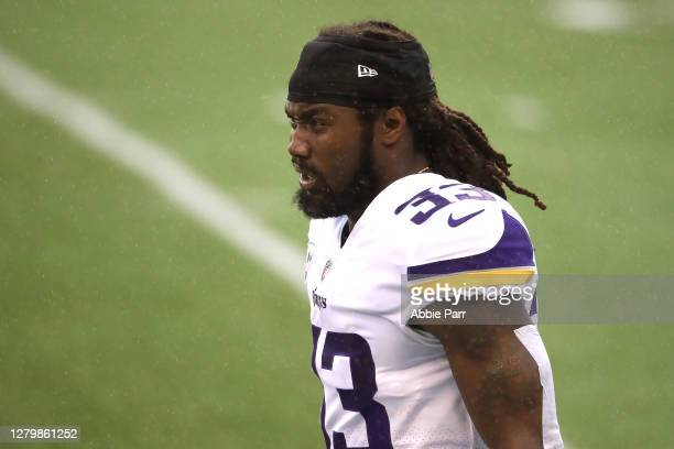 Dalvin Cook of the Minnesota Vikings looks on before their game against the Seattle Seahawks at CenturyLink Field on October 11, 2020 in Seattle,...