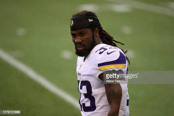 Dalvin Cook of the Minnesota Vikings looks on in the rain before the start of a game against the Seattle Seahawks at CenturyLink Field on October 11,...