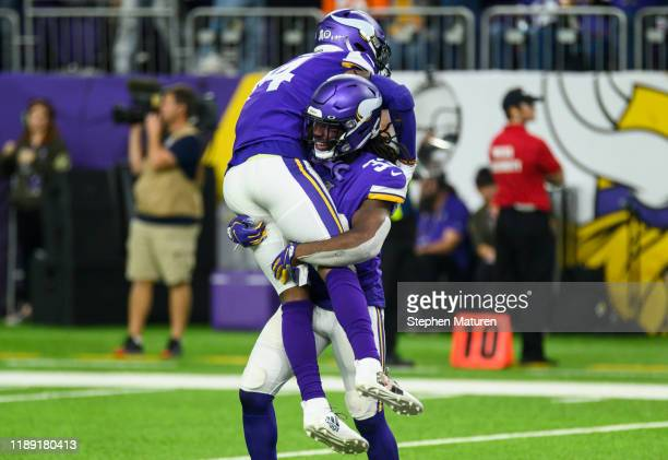 Dalvin Cook of the Minnesota Vikings picks up Stefon Diggs of the Minnesota Vikings while celebrating a touchdown score by Kyle Rudolph of the...
