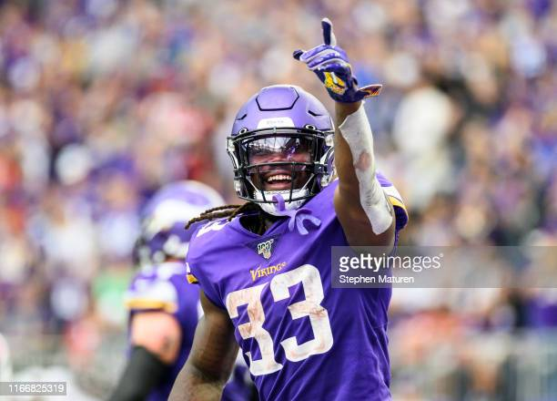 Dalvin Cook of the Minnesota Vikings points to the crowd after scoring a touchdown in the third quarter of the game against the Atlanta Falcons at...