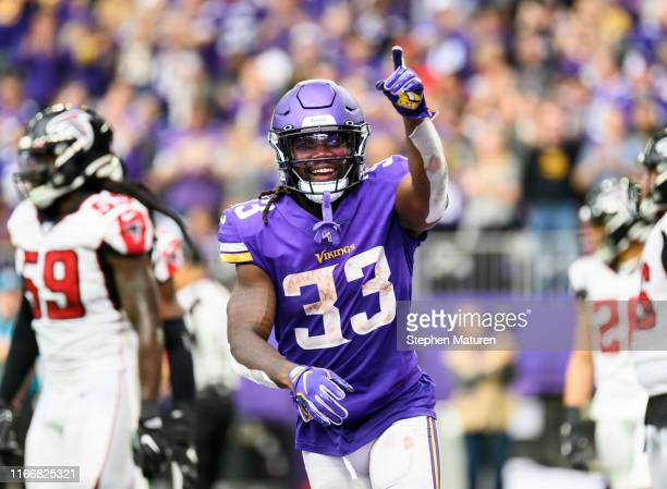 Dalvin Cook of the Minnesota Vikings points to the crowd after scoring a touchdown in the third quarter of the game against the Atlanta Falcons at US...