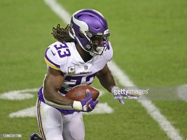 Dalvin Cook of the Minnesota Vikings runs against the Chicago Bears at Soldier Field on November 16, 2020 in Chicago, Illinois. The Vikings defeated...
