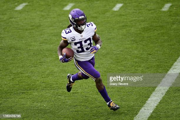 Dalvin Cook of the Minnesota Vikings runs for yards during a game against the Green Bay Packers at Lambeau Field on November 01, 2020 in Green Bay,...