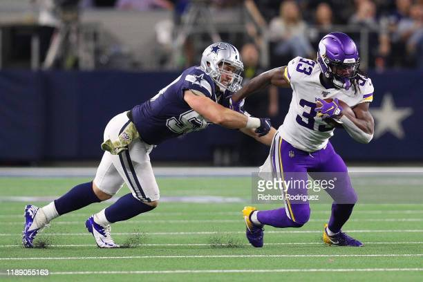 Dalvin Cook of the Minnesota Vikings runs the ball after evading Sean Lee of the Dallas Cowboys at AT&T Stadium on November 10, 2019 in Arlington,...