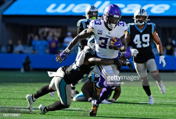 Dalvin Cook of the Minnesota Vikings runs the ball against Sean Chandler of the Carolina Panthers during the fourth quarter at Bank of America...