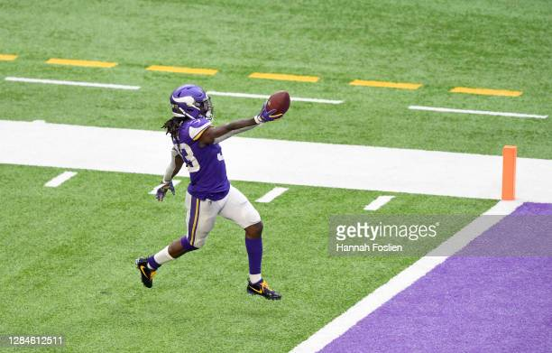 Dalvin Cook of the Minnesota Vikings runs the ball in for a touchdown against the Detroit Lions at U.S. Bank Stadium on November 08, 2020 in...
