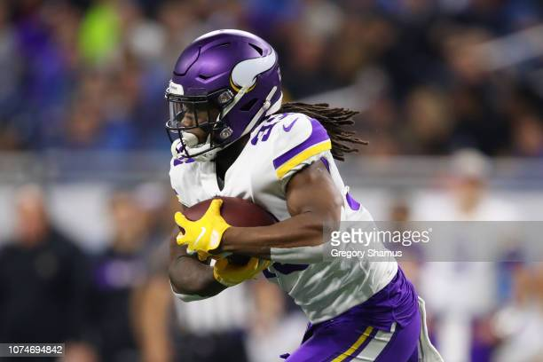 Dalvin Cook of the Minnesota Vikings runs the ball in the first half against the Detroit Lions at Ford Field on December 23, 2018 in Detroit,...