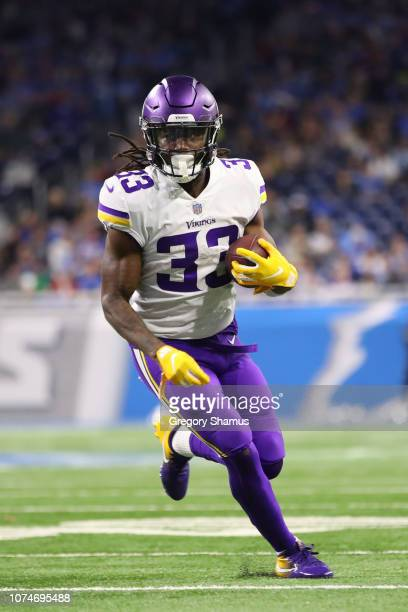 Dalvin Cook of the Minnesota Vikings runs the ball in the second half against the Detroit Lions at Ford Field on December 23, 2018 in Detroit,...