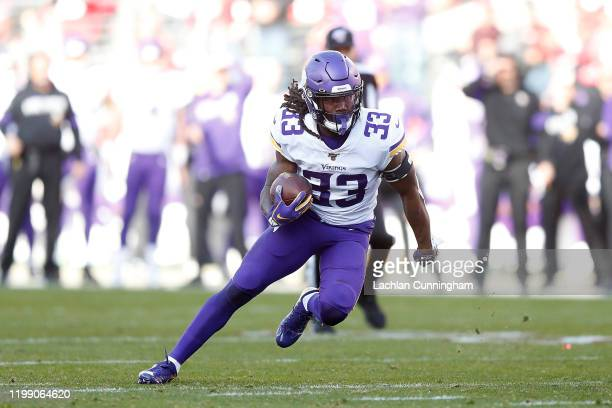 Dalvin Cook of the Minnesota Vikings runs the ball in the third quarter of the NFC Divisional Round Playoff game against the San Francisco 49ers at...