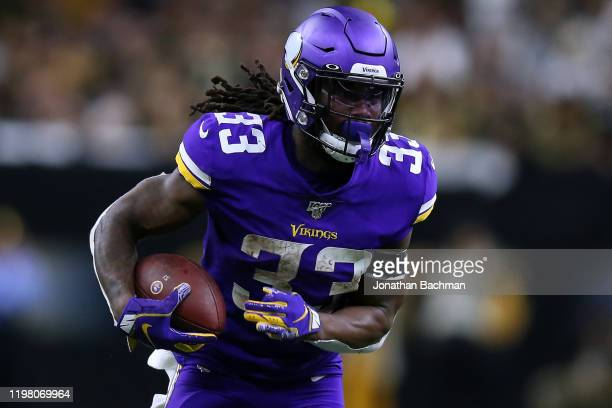 Dalvin Cook of the Minnesota Vikings runs with the ball against the New Orleans Saints during a game at the Mercedes Benz Superdome on January 05,...
