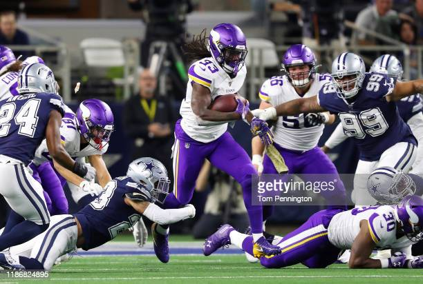 Dalvin Cook of the Minnesota Vikings runs with the ball during the first half against the Dallas Cowboys at AT&T Stadium on November 10, 2019 in...