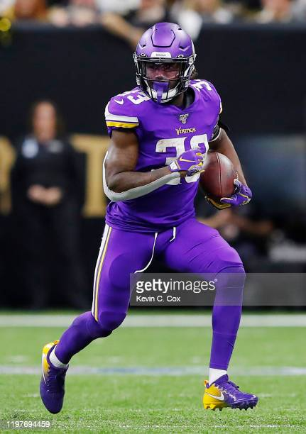 Dalvin Cook of the Minnesota Vikings runs with the ball during the first half against the New Orleans Saints in the NFC Wild Card Playoff game at...
