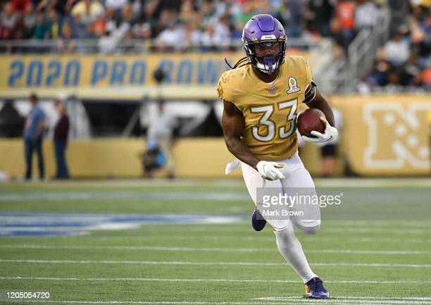 Dalvin Cook of the Minnesota Vikings runs with the ball during the 2020 NFL Pro Bowl at Camping World Stadium on January 26 2020 in Orlando Florida