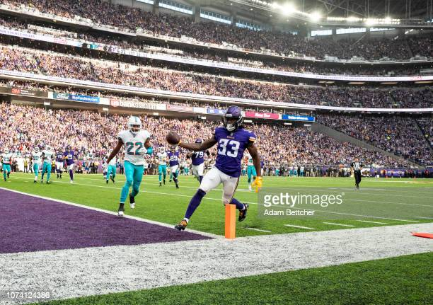 Dalvin Cook of the Minnesota Vikings runs with the ball for a 13 yard touchdown in the first quarter of the game against the Miami Dolphins at U.S....