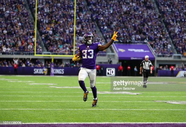 Dalvin Cook of the Minnesota Vikings runs with the ball for a 21 yard touchdown, his second of the day, in the fourth quarter of them game against...