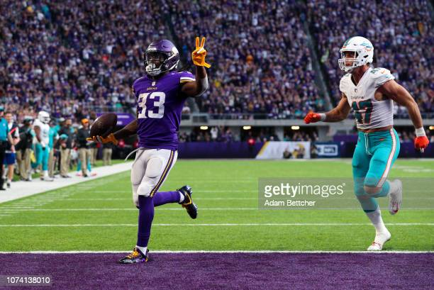 Dalvin Cook of the Minnesota Vikings runs with the ball for a 21 yard touchdown his second of the day in the fourth quarter of them game against the...