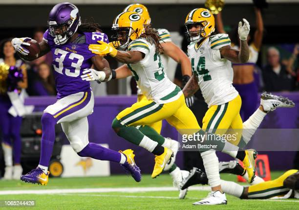 Dalvin Cook of the Minnesota Vikings runs with the ball for a 26yard touchdown in the first quarter of the game against the Green Bay Packers at US...