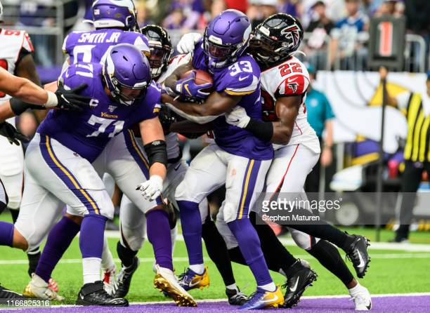 Dalvin Cook of the Minnesota Vikings runs with the ball for a touchdown in the third quarter of the game against the Atlanta Falcons at US Bank...