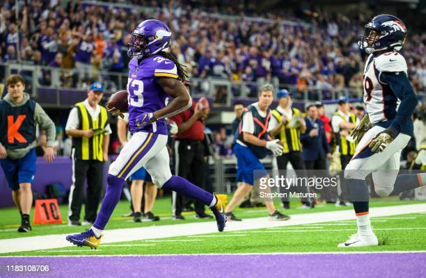 Dalvin Cook of the Minnesota Vikings runs with the ball for a touchdown in the fourth quarter of the game against the Denver Broncos at U.S. Bank...
