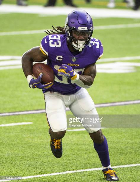 Dalvin Cook of the Minnesota Vikings runs with the ball in the second quarter of the game against the Chicago Bears at U.S. Bank Stadium on December...