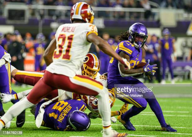 Dalvin Cook of the Minnesota Vikings runs with the ball in the third quarter of the game against the Washington Redskins at U.S. Bank Stadium on...