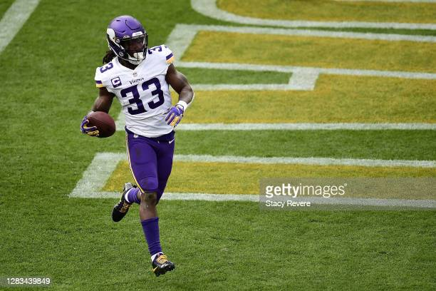 Dalvin Cook of the Minnesota Vikings rushes for a touchdown during a game against the Green Bay Packers at Lambeau Field on November 01, 2020 in...