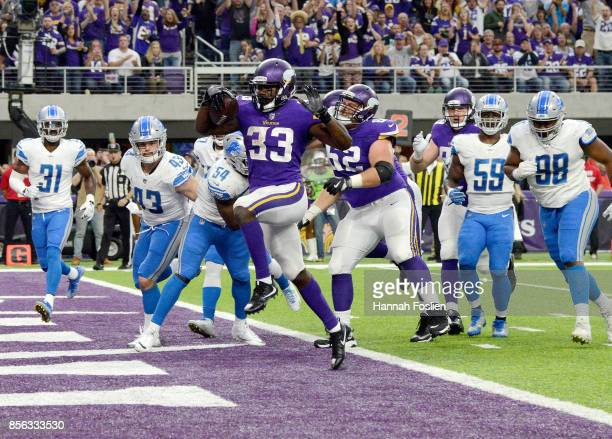 Dalvin Cook of the Minnesota Vikings scores a five yard rushing touchdown in the second quarter of the game against the Detroit Lions on October 1...