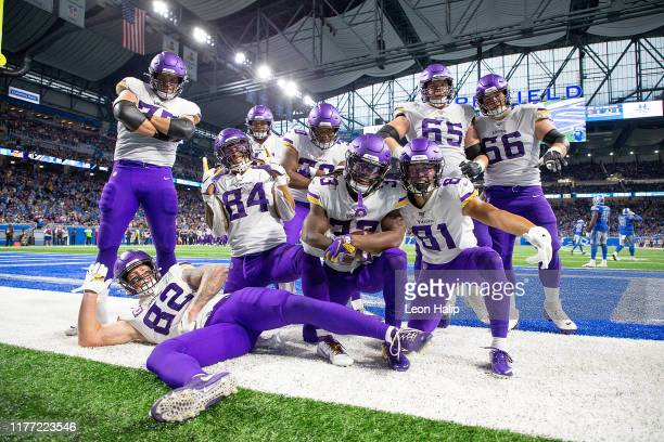 Dalvin Cook of the Minnesota Vikings scores a late fourth quarter touchdown and celebrates with his teammates in the end zone during the game against...