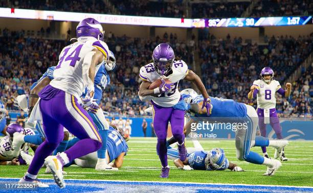 Dalvin Cook of the Minnesota Vikings scores a late fourth quarter touchdown during the game against the Detroit Lions at Ford Field on October 20,...