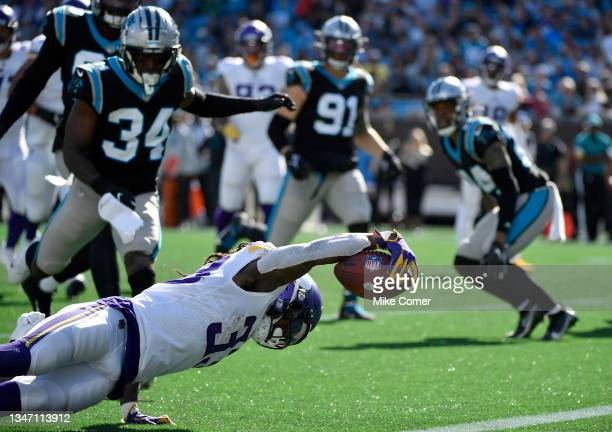 Dalvin Cook of the Minnesota Vikings scores a touchdown during the third quarter against the Carolina Panthers at Bank of America Stadium on October...