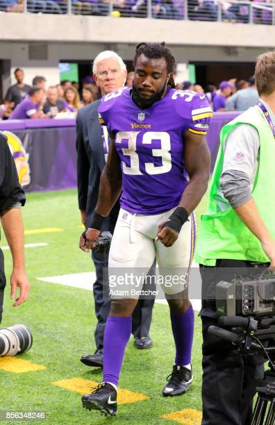 Dalvin Cook of the Minnesota Vikings walks into the locker room after getting injured on a play in the third quarter of the game against the Detroit...
