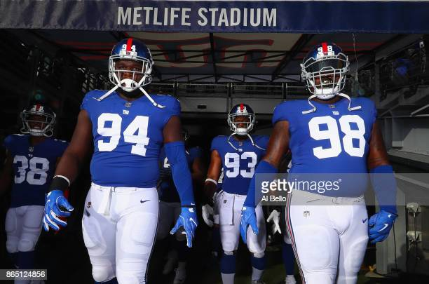 Dalvin Tomlinson BJ Goodson and Damon Harrison of the New York Giants walk out of the tunnel for warmups before taking on the Seattle Seahawks at...
