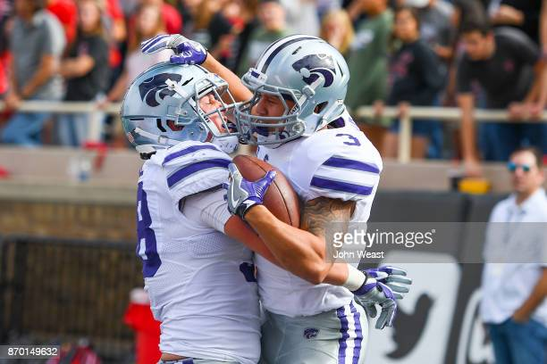 Dalvin Warmack of the Kansas State Wildcats celebrates a touchdown with Dayton Valentine of the Kansas State Wildcats during the first half of the...