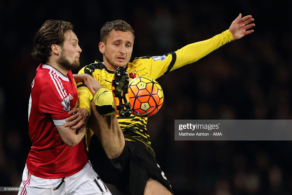 Daly Blind of Manchester United and Almen Abdi of Watford during the Barclays Premier League match between Manchester United and Watford at Old Trafford on March 02, 2016 in Manchester, England.