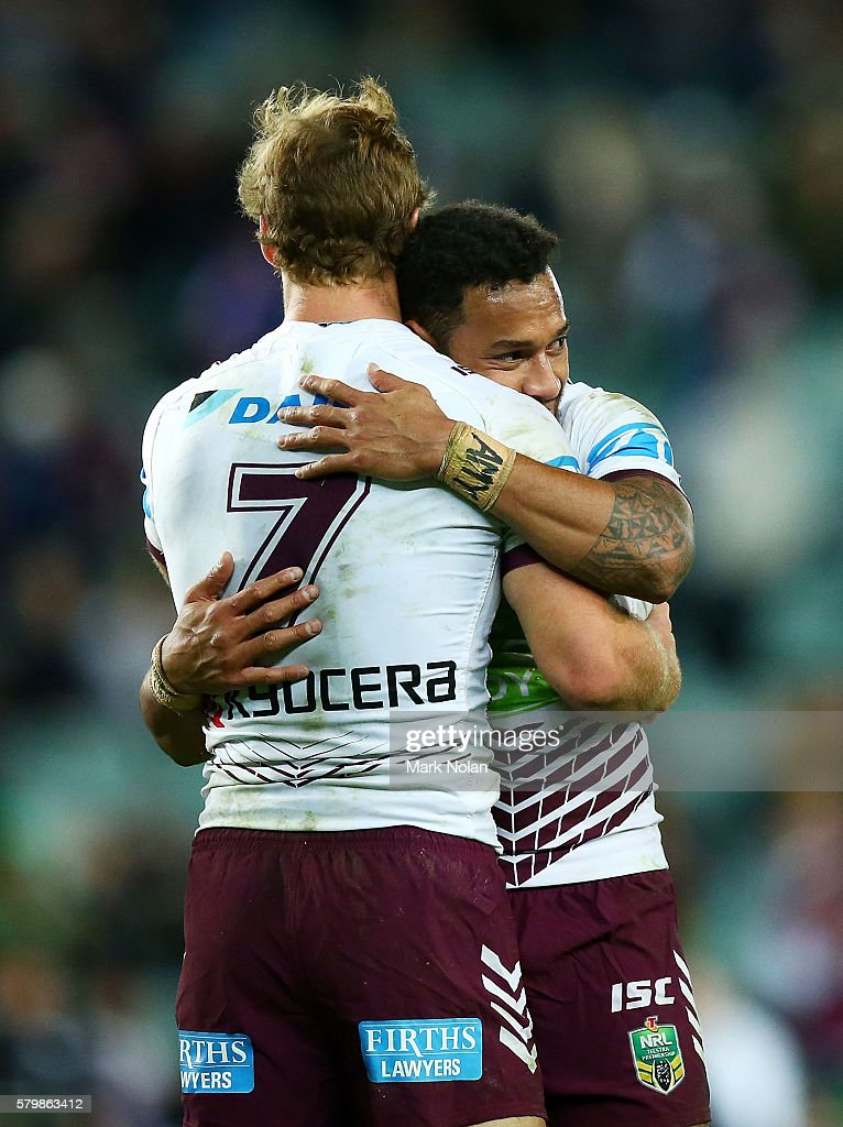 Daly Cherry-Evans and Apisai Koroisau of the Eagles embrace after winning the round 20 NRL match between the South Sydney Rabbitohs and the Manly Sea Eagles at Allianz Stadium on July 25, 2016 in Sydney, Australia.