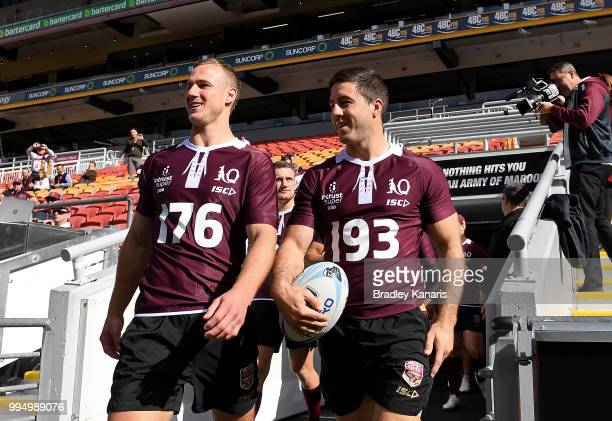 Daly CherryEvans and Ben Hunt enter the field together during the Queensland Maroons State of Origin Captain's Run at Suncorp Stadium on July 10 2018...