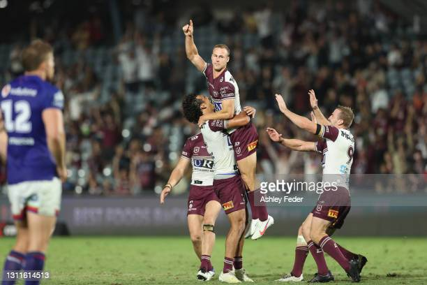 Daly Cherry-Evans celebrates his field goal and the win with team mates during the round five NRL match between the New Zealand Warriors and the...