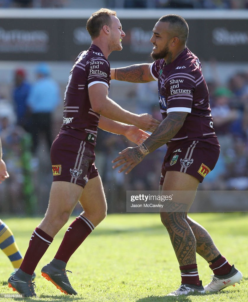 Daly Cherry-Evans celebrates with Addin Fonua-Blake of the Sea Eagles after scoring a try during the round two NRL match between the Manly Sea Eagles and the Parramatta Eels at Lottoland on March 18, 2018 in Sydney, Australia.