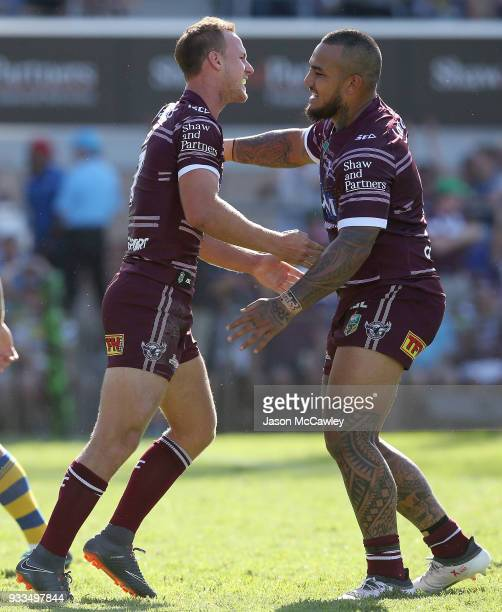 Daly CherryEvans celebrates with Addin FonuaBlake of the Sea Eagles after scoring a try during the round two NRL match between the Manly Sea Eagles...