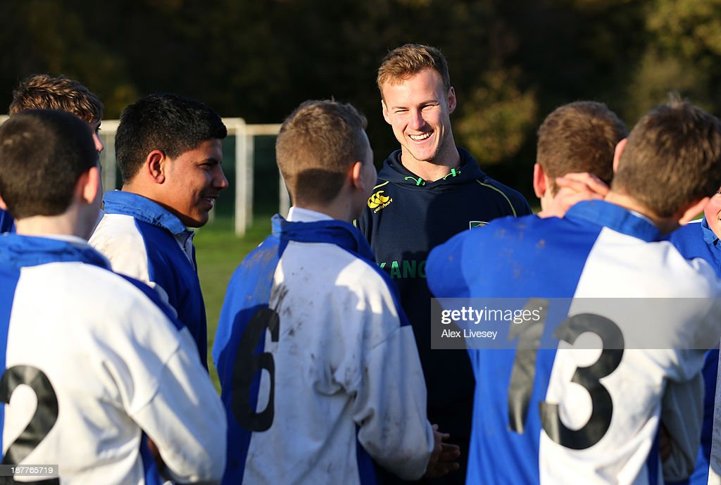 Daly Cherry-Evans of Australia gives out coaching tips to school boys from seven different schools to help kick off the Mancunians inaugural Year 10 tournament the largest Rugby League schools event held in the city of Manchester at Parrswood High School on November 12, 2013 in Manchester, England.