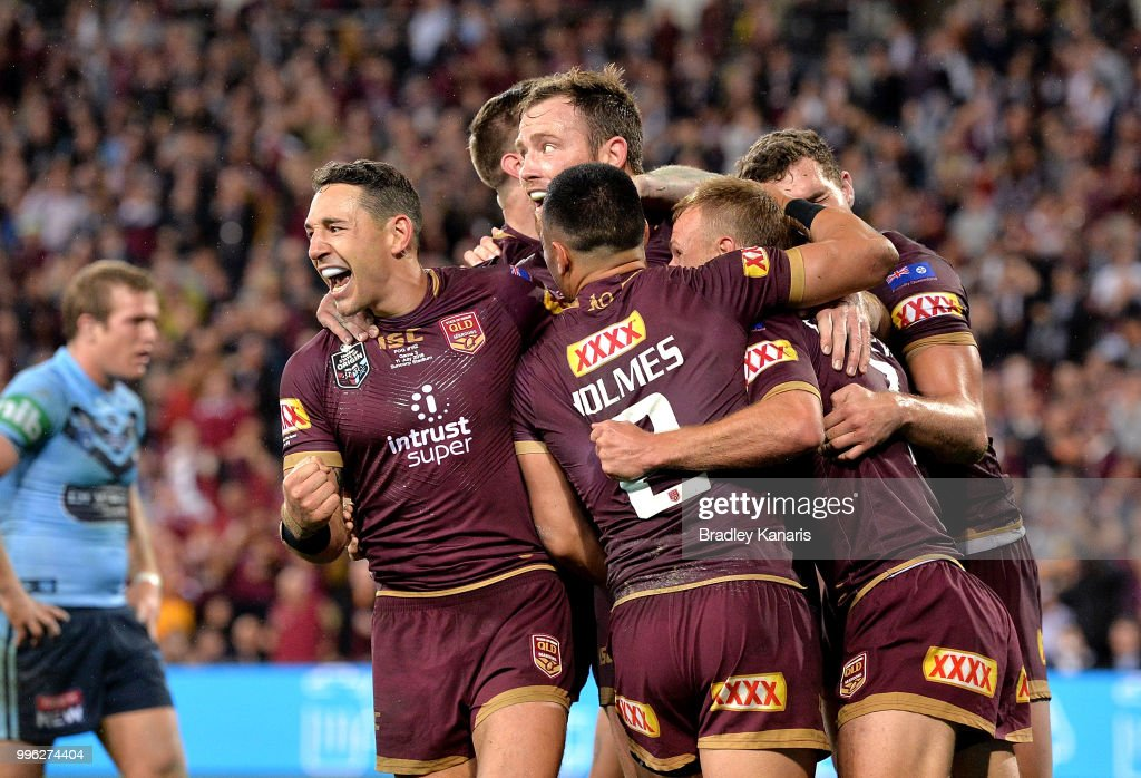 Daly Cherry-Evans of Queensland is congratulated by Billy Slater and team mates after scoring a try during game three of the State of Origin series between the Queensland Maroons and the New South Wales Blues at Suncorp Stadium on July 11, 2018 in Brisbane, Australia.
