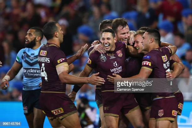 Daly Cherry-Evans of Queensland is congratulated by team mates after scoring a try during game three of the State of Origin series between the...