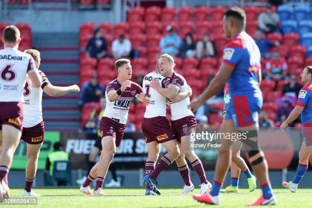 Daly Cherry-Evans of the Manly Sea Eagles celebrates a try with team mates during the round 14 NRL match between the Newcastle Knights and the Manly...