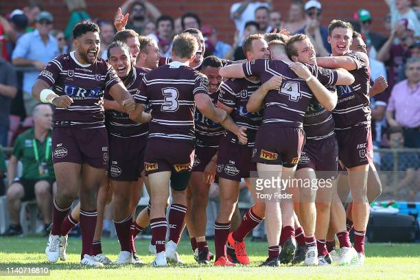 Daly CherryEvans of the Manly Sea Eagles celebrates with team mates after kicking a goal in golden point to win the game during the round four NRL...