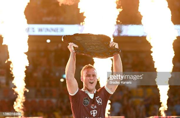 Daly Cherry-Evans of the Maroons celebrates victory as he holds up the winners shield after game three of the State of Origin series between the...