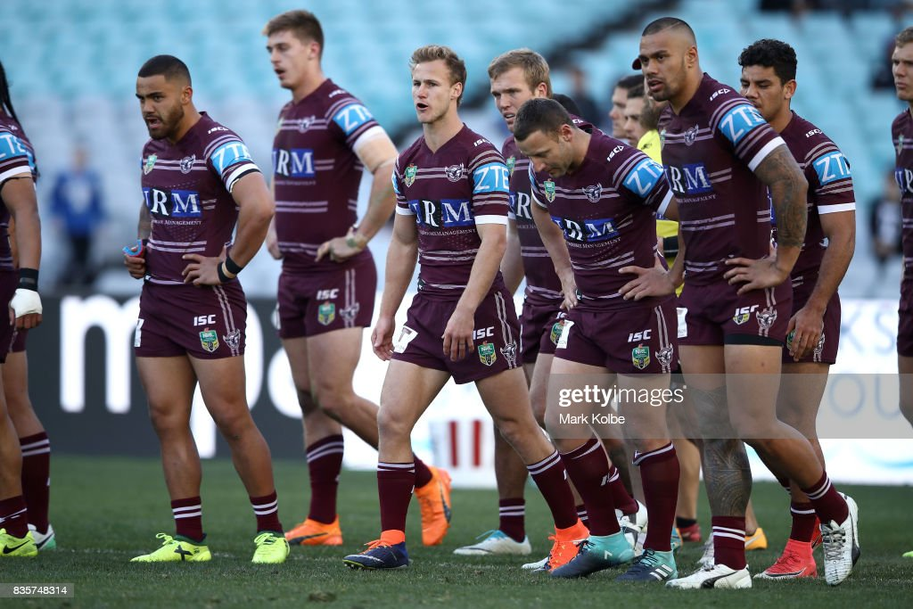 Daly Cherry-Evans of the Sea Eagles and his team mates look dejected after a Bulldogs during the round 24 NRL match between the Canterbury Bulldogs and the Manly Sea Eagles at ANZ Stadium on August 20, 2017 in Sydney, Australia.