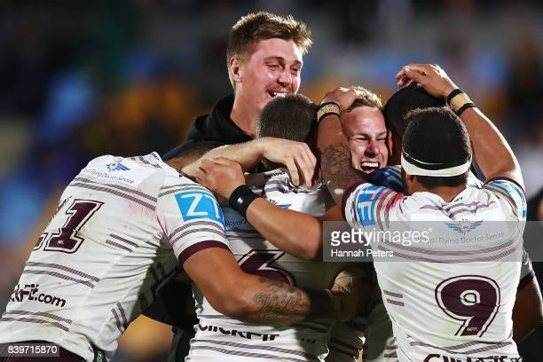 Daly CherryEvans of the Sea Eagles celebrates after kicking a field goal in extra time to win the round 25 NRL match between the New Zealand Warriors...