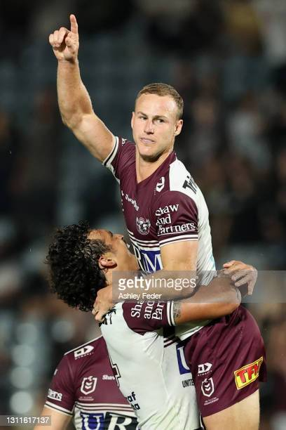 Daly Cherry-Evans of the Sea Eagles celebrates his field goal and the win with team mates during the round five NRL match between the New Zealand...