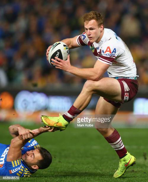 Daly CherryEvans of the Sea Eagles evades the tackle of Ryan Morgan of the Eels during the round 24 NRL match between the Parramatta Eels and the...